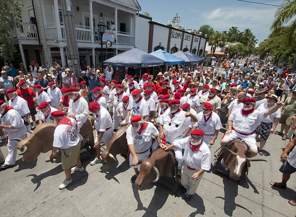 Ernest Hemingway look- alikes kick off the Running of the Bulls Saturday, July 19, 2014, in Key West, Fla. The whimsical event, a parody of its namesake in Pamplona, Spain, is one of many events during Key West's Hemingway Days festival that continues through Sunday, July 20. Hemingway lived and wrote in Key West throughout most of the 1930s. FOR EDITORIAL USE ONLY (Andy Newman/Florida Keys News Bureau/HO)