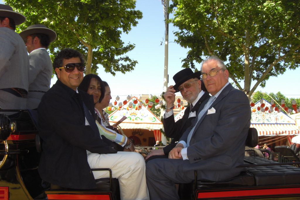 Feria de Sevilla 2009. Rolf and friends, doing the paseo. On the left his lawyer from Bogata, Eduardo, and wife Nora. Then there's Esperanza, wife of…Adolfo, who is sitting on the right next to Rolf. Esperanza and Adolfo are owners of one of his favourite Feria de Sevilla casetas, and this is their private horse carriage, drawn by six black Arab stallions.